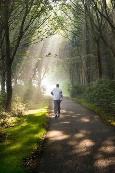 older man jogging in park